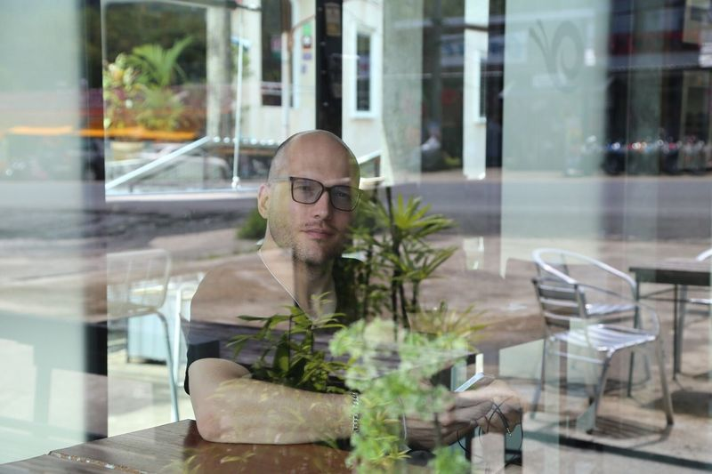 Reflection Of Man On Glass