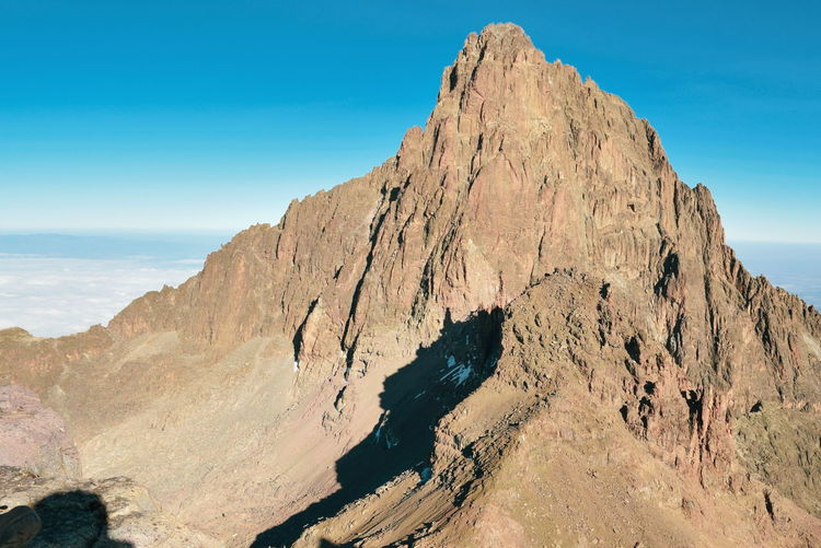 Mount kenya's highest peak, batian peak above the clouds at mount kenya