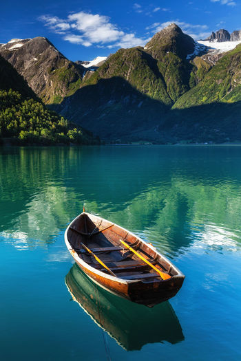 Scenic view of lake by mountains against sky, hjelle, norway