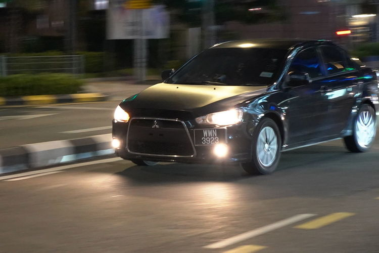 Architecture Black Color Blurred Motion Built Structure Car City Evo X Headlight Illuminated Land Vehicle Luxury Mitsubishi Mode Of Transportation Motion Motor Vehicle Night No People on the move Outdoors Road Speed Street Transportation Travel