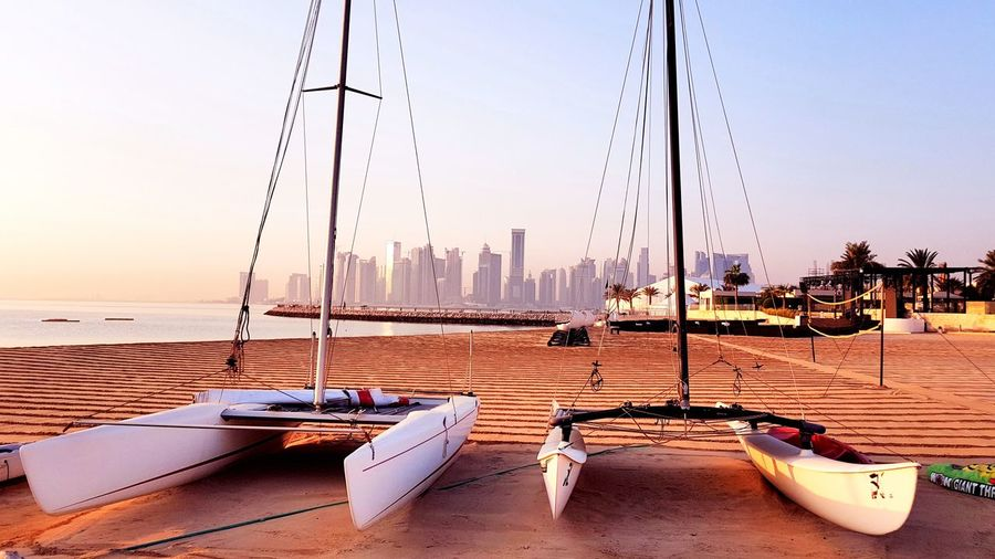 Boats⛵️ Transportation Clear Sky Travel Photography Outdoors Net Beachphotography No People, Samsung Galaxy S7 Edge Streetphotography Morning Sun Morning Mode Of Transport Places To Visit Relax City View  Parking Doha,Qatar Doha_photography Morning Sky Morning Sunrise Beach City Pattern Textured  Stories From The City Boat Sailing Boat