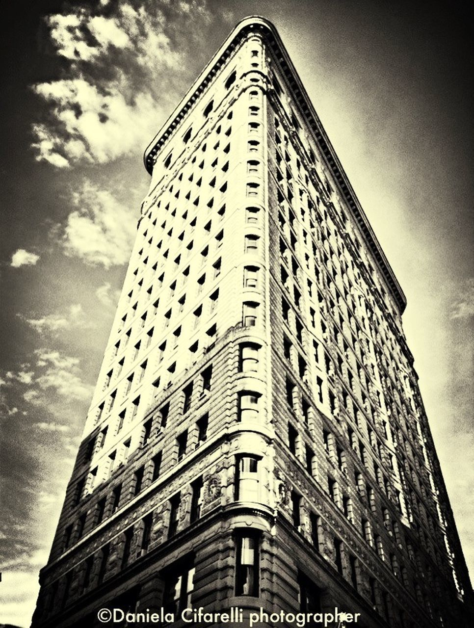 low angle view, architecture, building exterior, built structure, skyscraper, sky, cloud - sky, day, no people, outdoors, city, travel destinations
