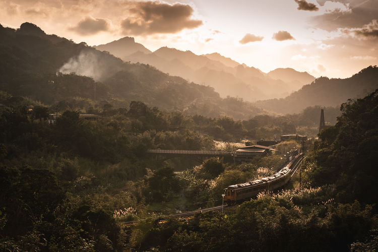 Train in the mountains during sunset