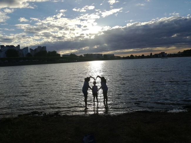 Water Silhouette Outdoors Child Beauty In Nature People Sunset Scenics Love Togheter Forever Lac Lake Kids Kids Having Fun Real People Standing Best Of EyeEm Silhouette Reflection In The Water