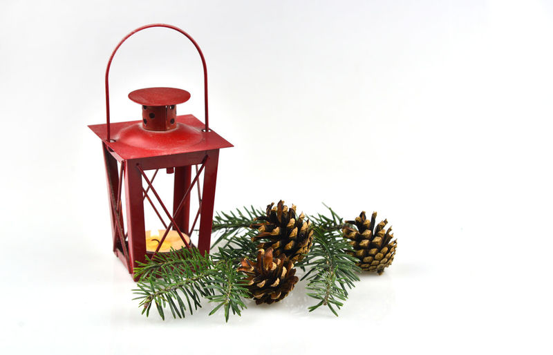 Close-up of lantern on table against white background