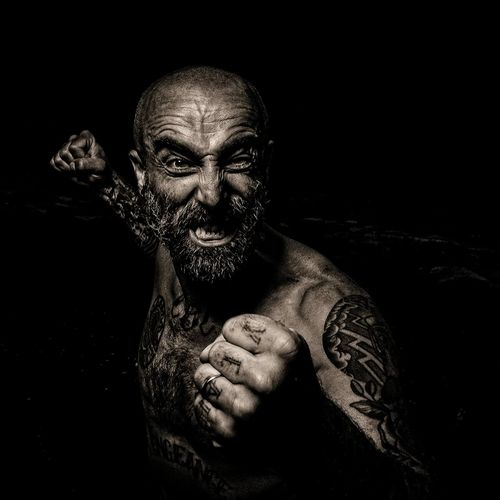 baguarre Guntphotoart Sepiatone Bnwportrait PortraitPhotography ManWithTattoos Manwithbeard Man MadeInFrance Halloween Spooky Evil Horror Looking At Camera Close-up