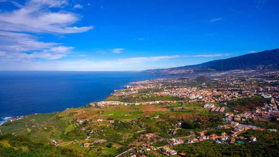 This panoramic photograph, taken at a Mirador in Los Realejos, shows the north coast of Tenerife and the Orotava Valley. Tenerife Teneriffa Los Realejos SPAIN Canary Islands Icod El Alto Travel Travel Photography Landscape Coastline Coast Atlantic Ocean Panorama Panoramic View Mountain La Orotava Puerto De La Cruz Orotava Valley Sea Water Scenics - Nature Sky Horizon Horizon Over Water Blue Beauty In Nature Nature Cloud - Sky Architecture Beach Land No People Tranquil Scene Day Tranquility Building Exterior Outdoors Bay