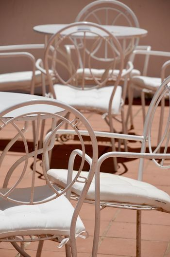 White Chairs Chair Seat Absence Table No People Focus On Foreground Empty Restaurant Dining Table Close-up Setting Food And Drink Day Cafe Furniture Chair