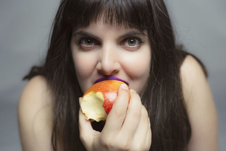 Portrait Of Young Woman Eating Apple