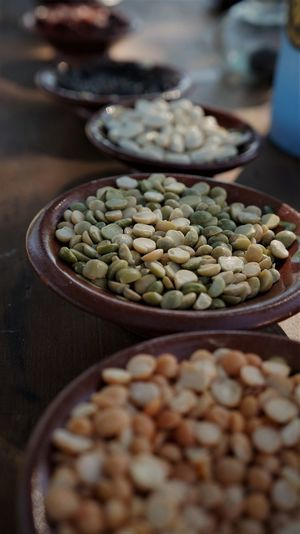 High angle view of lentils and beans in bowl on table