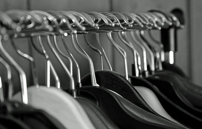Close-up of empty coathangers on rack