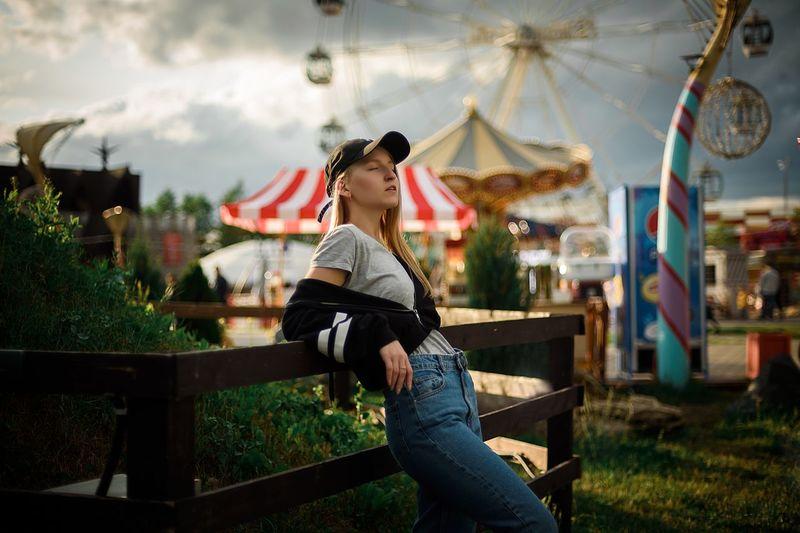 Woman sitting at amusement park