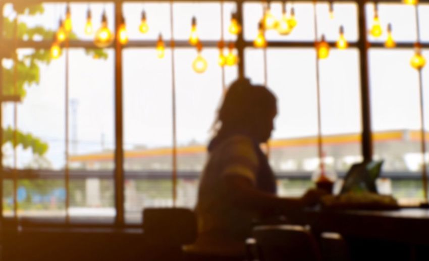 Transportation Airport One Person Real People Focus On Foreground Travel Sitting Window Indoors  Mode Of Transportation Adult Airport Departure Area Waist Up Silhouette Side View Women Looking Airport Terminal Waiting