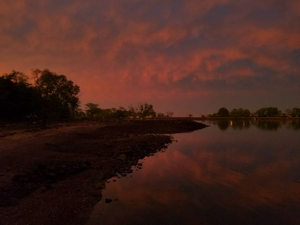 A perfect end to a stormy day!! Sunset photo taken at Five Islands Park, New Rochelle on May 15th, 2018. Beach Orange Water Sunset Tree Reflection Sky Landscape Cloud - Sky Shore Standing Water Romantic Sky Low Tide Calm