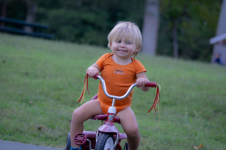 Riding Outdoors Blond Hair Bicycle Smiling Cute Front View Looking At Camera Innocence Casual Clothing Portrait One Person Real People Child Childhood
