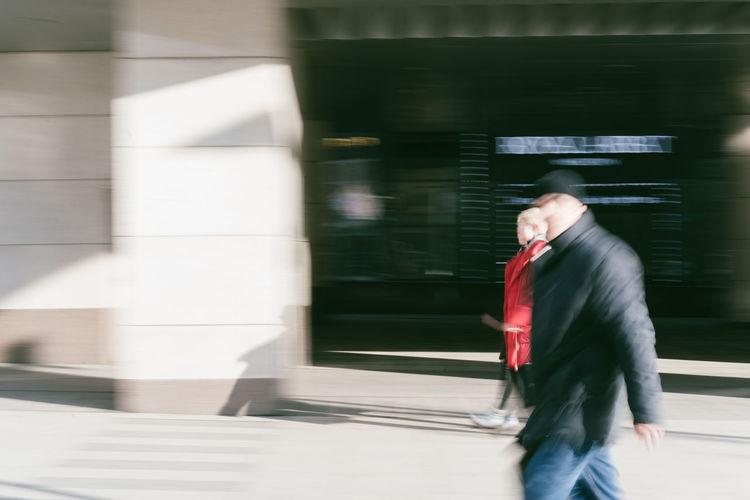 Full length of man walking at railroad station