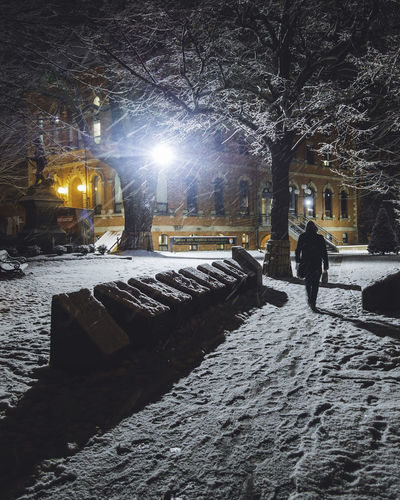 A person walking under the heavy snow in downtown Charlottetown, Canada Charlottetown City Cityscape Downtown Winter Black Building Canada Light And Shadow Night Outdoor Park Pei People person Prince Edward Island Snow Snowfall Snowing Walking White Winter Wonderland