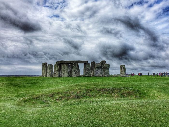 Neolithic Wonder Neolithic Stones Stone Henge History UNESCO World Heritage Site Travel Destinations Travel Photography Landscape Grass Storm Cloud Cloud - Sky Cloudy Dramatic Sky Nature Field United Kingdom Famous Place Engineering Ruins Druid's Secret Place Druids Sky