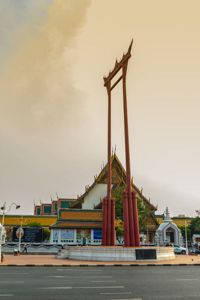 Vintage view of the Giant Swing, a religious structure which located in front of Wat Suthat temple. It was used in the Brahmin ceremony and is one of Bangkok famous tourist attraction. Crowd Of Pigeon Giant Swing Giant Swing Bangkok Red Giant Swing Sao Ching Cha Tourist Attraction  Wat Suthat Wat Suthat Thepwararam Architecture Building Exterior Built Structure City Cloud - Sky Construction Equipment Construction Industry Construction Site Crane - Construction Machinery Day Development Industry Low Angle View Machinery Mode Of Transportation Nature No People Outdoors Sky Tourist Attraction In Thailand Tourist Attractions Tourist Attractions, Tourist Destinations, City Life, Leisure Activities, Transportation Travel