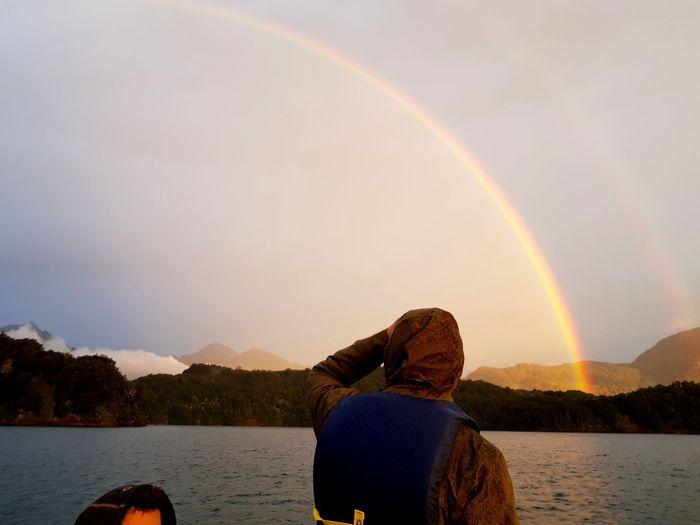 En medio de una tormenta en el sur de Chile, un arcoiris. Water Mountain Spectrum Tree Refraction Rainbow Reflection Lake Sky Double Rainbow Freshwater Calm Tranquil Scene Natural Arch Idyllic Non-urban Scene Scenics Diving Platform