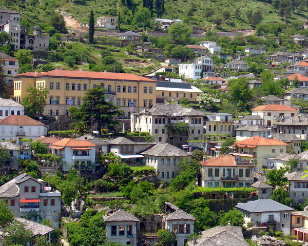 Aerial view of Gjirokaster, Albania Albania Gjirokaster Aerial View Architecture Building Exterior Built Structure City Cityscape Day House No People Outdoors Residential Building Roof Tree Viewpoint