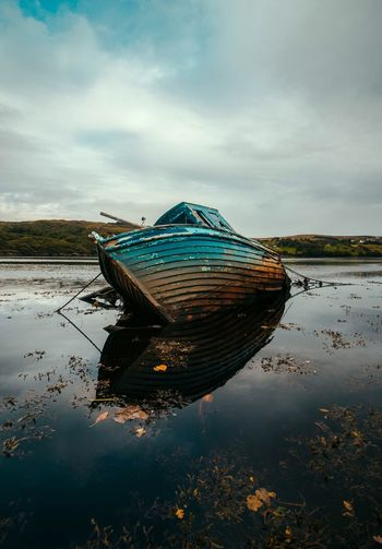 Boat in Ireland Ireland🍀 Ireland Ship Boat Abandoned Nautical Nautical Vessel Nature No People Beach Mode Of Transportation Scenics - Nature Land Day Beauty In Nature Tranquility Outdoors Tranquil Scene Moored Fishing Industry