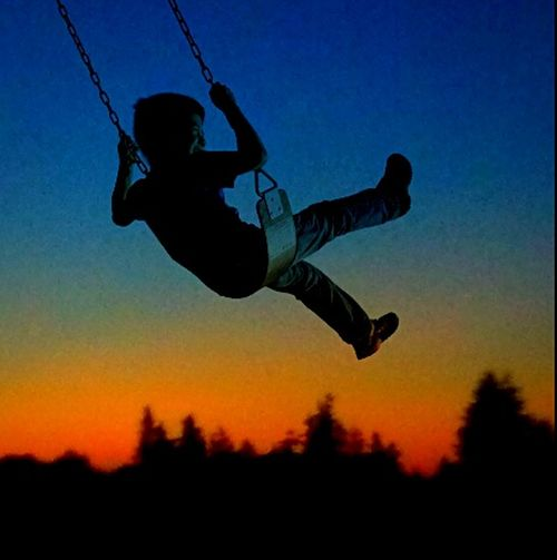 Silhouette Mid-air One Person Motion Sunset People Swing Childsplay Swinging High Horizon Love Photography Oregon Glow Showcase July Feel The Journey Special Moment The Portraitist - 2017 EyeEm Awards Tranquility From My Point Of View Arts Culture And Entertainment Vacations Be Young Nostalgic Moment Making Memories Oregon Art Into The Sky