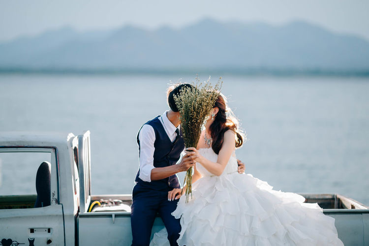 Kiss Wedding Wedding Photography Adult Bonding Bride Bridegroom Couple - Relationship Event Life Events Love Married Men Nature Newlywed Outdoors Positive Emotion Real People Togetherness Two People Water Wedding Wedding Dress Wife Women