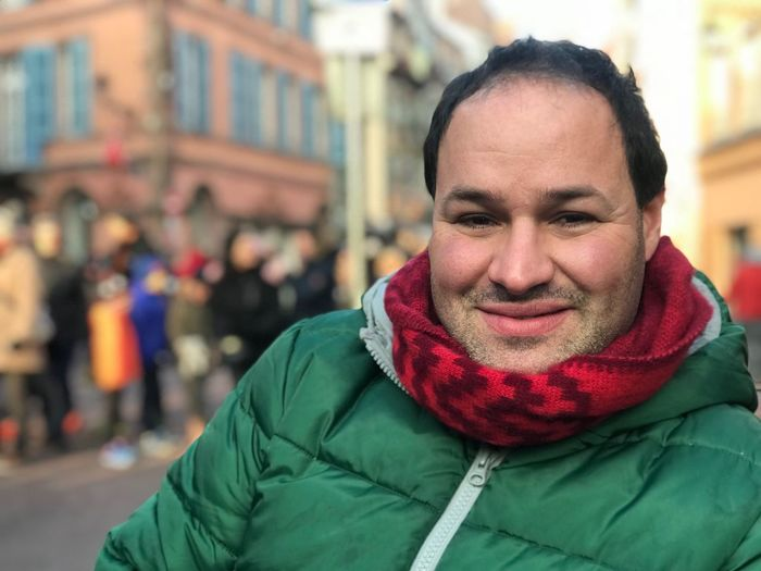 Portrait of smiling man in warm clothing outdoors