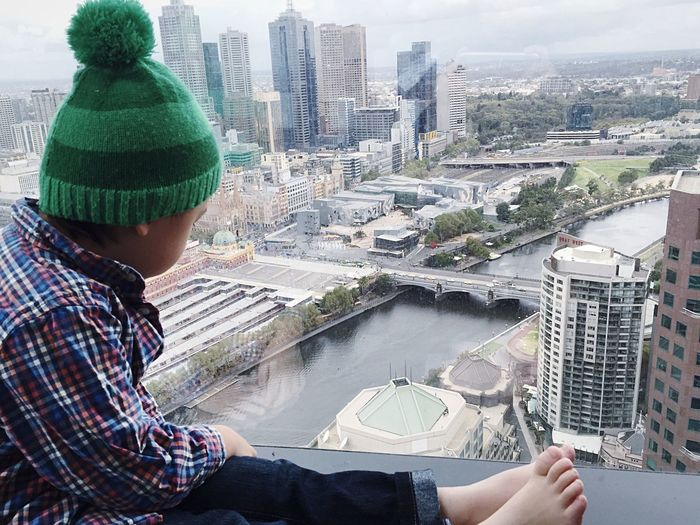 Boy Wearing Knit Hat While Looking At Cityscape
