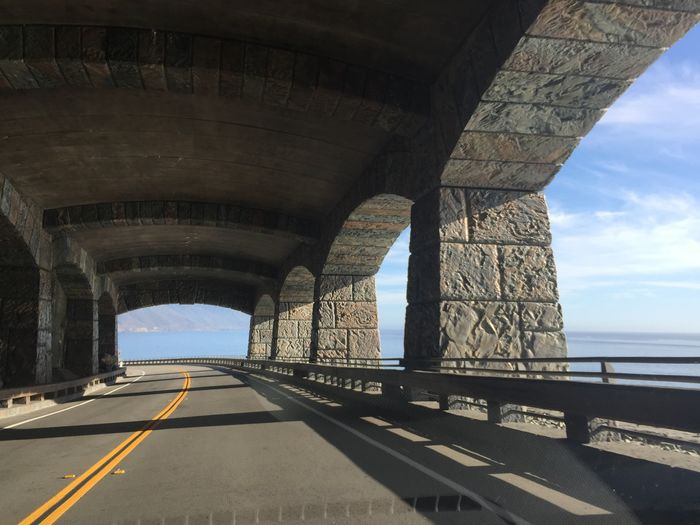 Route 1 Transportation Architecture Sky Road Built Structure Connection Nature Bridge Direction The Way Forward Bridge - Man Made Structure Road Marking Sea Marking No People Water Sign Arch Day Diminishing Perspective Outdoors Dividing Line