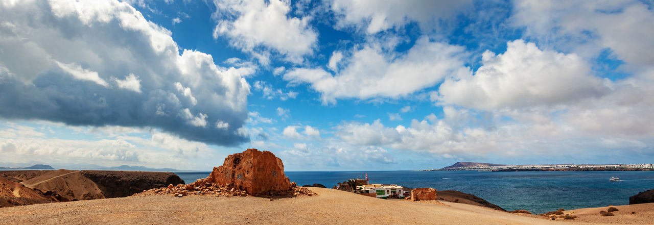 Playa del Papagayo, Lanzarote, Spain Spanje Cloud - Sky Sky Scenics - Nature Beauty In Nature Tranquility Tranquil Scene Sea Water Land Day Nature Non-urban Scene Rock Beach Rock - Object No People Rock Formation Idyllic Solid Outdoors Panorama Lanzarote