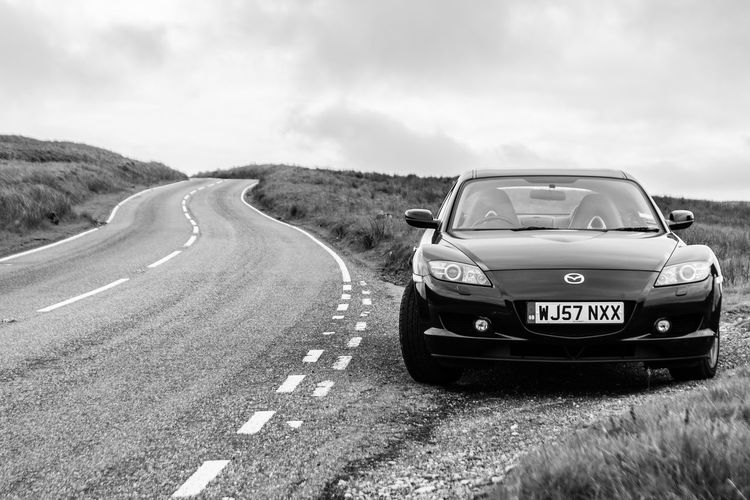 The Mazda RX-8 Black And White Black And White Photography Cars Cloudy Country Road Diminishing Perspective Fast Cars Land Vehicle Landscape Mazda Mood Mountain Nature Road Sky Sports Car Travel Traveling Visual Creativity A New Beginning British Culture