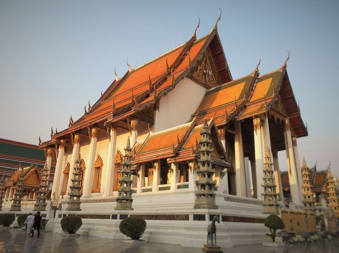 Wat Suthat Architecture Building Exterior Built Structure Clear Sky Day History Outdoors People Place Of Worship Religion Sky Spirituality Temple - Building Travel Destinations