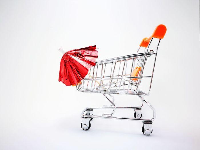 mini umbrella in trolley Mini Umbrellas Umbrella Trolley EyeEm Selects EyeEmNewHere Shopping Cart Consumerism Retail  Buying Supermarket E-commerce Studio Shot White Background Indoors  Customer