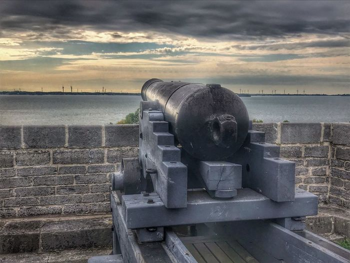 Protecting the city Sky Cloud - Sky Water Nature Sunset No People Sea History Scenics - Nature Cannon Old Weapon Outdoors Day Land The Past Metal