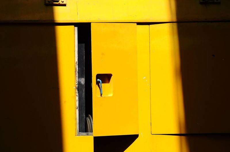Sunlight falling on open yellow door