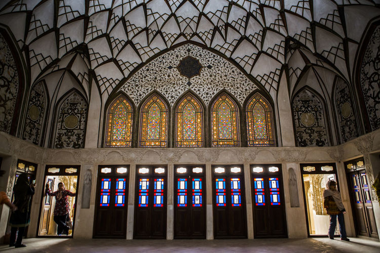 Tanatabai House is one of most beautiful house in Kashan city, in one of main Rooms i took this picture with people who taking Selfies and walking into this room i love architect in Kashan, in 1834 this house was made by Seyed Jafar Tabatabai, he was Rug merchant and he was so rich person at Qajar age. Arch Architecture Clothes Dress Indoors  Iran Iranian Iranian People Kashan People Qajar Dress Tabatabai The Architect - 2017 EyeEm Awards The Great Outdoors - 2017 EyeEm Awards The Photojournalist - 2017 EyeEm Awards The Portraitist - 2017 EyeEm Awards Traditional Clothing Traditional Costume Travel Destinations Window BYOPaper! Live For The Story Let's Go. Together. Breathing Space Mix Yourself A Good Time EyeEm Ready   Colour Your Horizn Press For Progress 17.62°