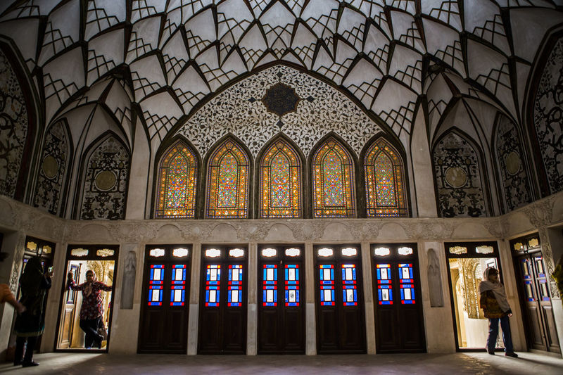 Tanatabai House is one of most beautiful house in Kashan city, in one of main Rooms i took this picture with people who taking Selfies and walking into this room i love architect in Kashan, in 1834 this house was made by Seyed Jafar Tabatabai, he was Rug merchant and he was so rich person at Qajar age. Arch Architecture Clothes Dress Indoors  Iran Iranian Iranian People Kashan People Qajar Dress Tabatabai The Architect - 2017 EyeEm Awards The Great Outdoors - 2017 EyeEm Awards The Photojournalist - 2017 EyeEm Awards The Portraitist - 2017 EyeEm Awards Traditional Clothing Traditional Costume Travel Destinations Window BYOPaper! Live For The Story Let's Go. Together. Breathing Space Mix Yourself A Good Time EyeEm Ready   Colour Your Horizn Press For Progress