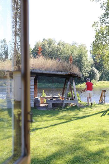 Tree Grass Day Leisure Activity One Person Nature Outdoors Real People People Sky Adult Fire Grill BBQ Outdoor Activity Summer Dalecarlia Dalarna Nature On Your Doorstep Nature Through The Window Unrecognizable Person Beauty In Nature Sweden Swedish Nature