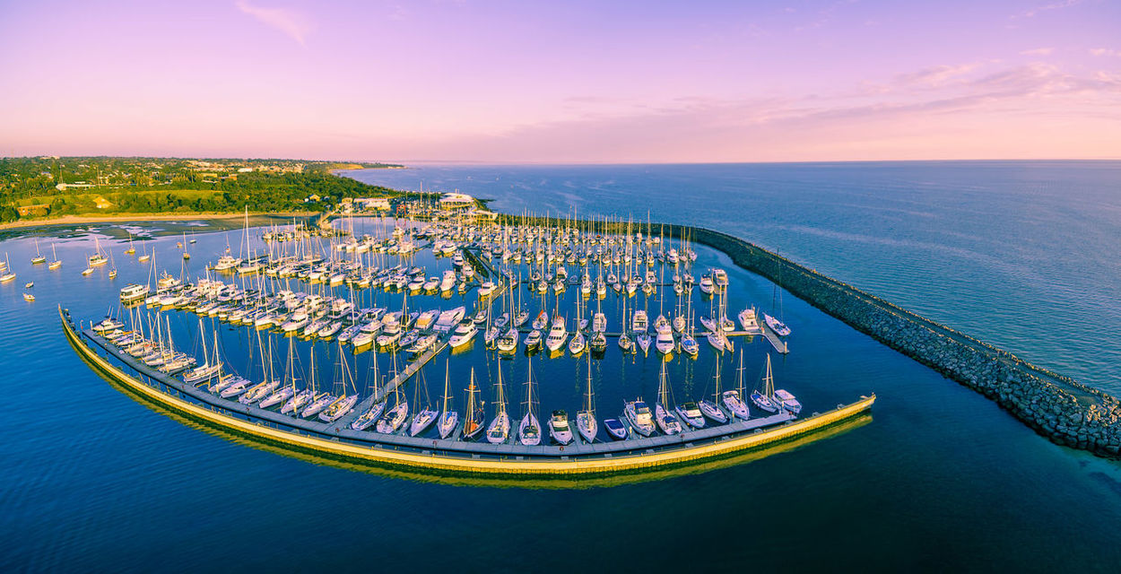 Aerial panoramic view of moored sailboats, breakwater, and Melbourne coastline at beautiful sunset Aerial Aerial Landscape Aerial Panorama Aerial View Architecture Boats Day High Angle View Horizon Over Water Marina Melbourne No People Outdoors Sea Sky Sunset Water Yachts