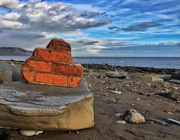 House by the sea Beauty Of Decay Bright Colors Debris Jurrasic Coast Atmospheric Atmospheric Mood Beach Debris Beauty In Ordinary Things Blue Sky And Clouds Coastal Coastal Landscape House Brick Orange Blue Orange Color Pebbles And Stones Pebbles On A Beach Rocks On The Shore Sea Sea And Sky Seascape Seaside Be. Ready. EyeEm Ready
