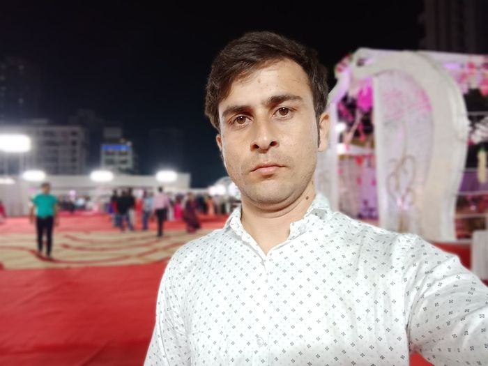 Portrait of young man during wedding ceremony