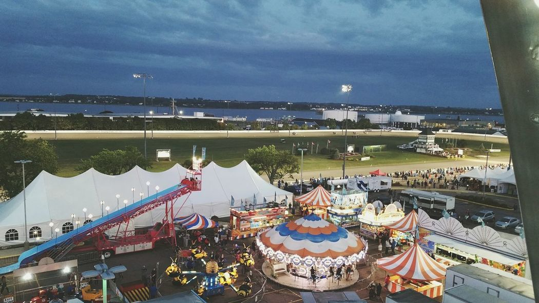 Summertime traditions High Angle View Exhibition Farris Wheel Slide View Games Track Horse Racing Summertime Summer Views Dusk Dusk Sky Rides At Fair Rides East Coast Vibes East Coast Canada Canada Pei Outdoors Arts Culture And Entertainment East Coast
