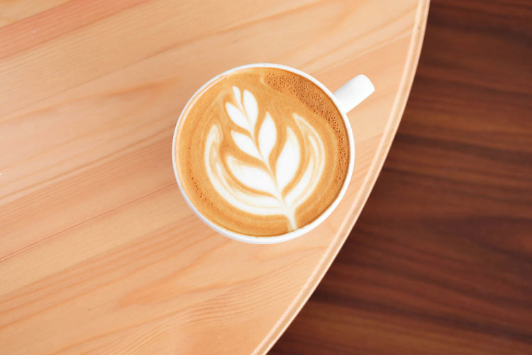 Coffee - Drink Coffee Refreshment Coffee Cup Cup Mug Drink Food And Drink Frothy Drink Still Life Hot Drink Froth Art Cappuccino Table Wood - Material High Angle View Latte Close-up Creativity Freshness No People Crockery Non-alcoholic Beverage Caffeine