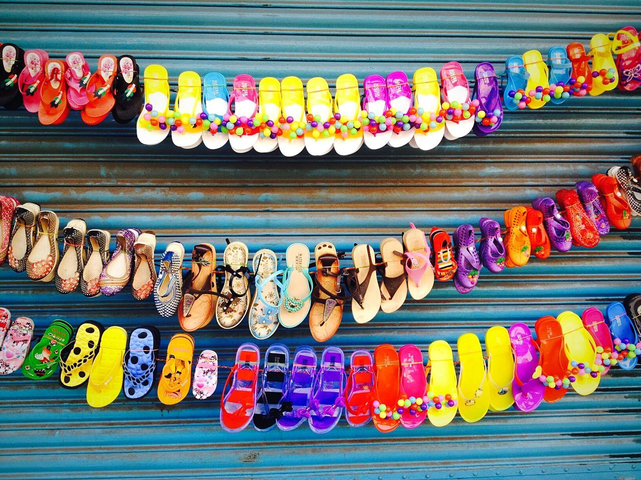 CLOSE-UP OF MULTI COLORED OBJECTS FOR SALE IN MARKET STALL