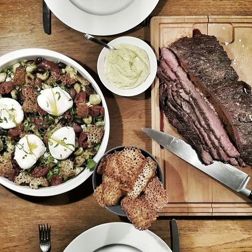 Directly Above Shot Of Flap Steak Served With Brussels Sprouts Salad With Poached Eggs