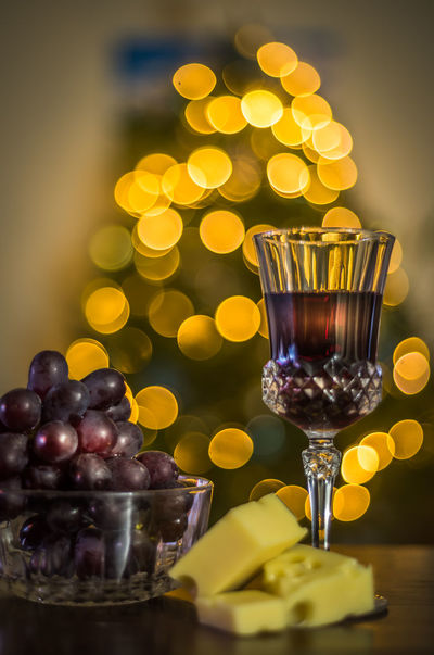 Cheese And Wine Christmas Holidays New Year Red Wine Alcohol Close-up Dessert Drink Drinking Glass Food Food And Drink Freshness Fruit Grapes Illuminated Indoors  Indulgence New Year Celebration Ready-to-eat Refreshment Still Life Sweet Food Temptation Wineglass