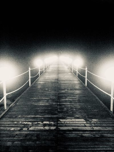 Follow the path and trust that it takes you to good places! Blackandwhite Illuminated Direction Lighting Equipment The Way Forward Night Railing A New Beginning No People Diminishing Perspective Connection Light - Natural Phenomenon Light Outdoors Nature