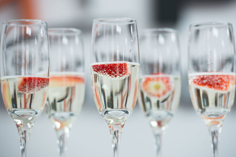 Champagne Champagne Flute Champagne Glasses Choice Day Drink Drinking Glasses Elégance Floating Food And Drink Freshness Glasses In A Row Indoors  Large Group Of Objects No People Sparkling Wine Strawberries Temptation Wine Wine Moments